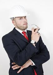 thinking architect with helmet on isolated background.