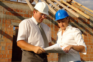 Female and male building engineers