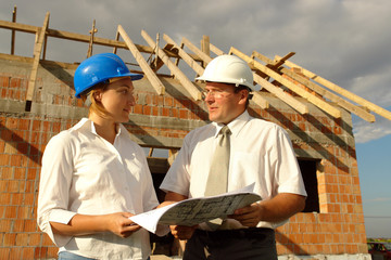 Female and male building designers