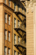 brownstone fire escape in between two buildings