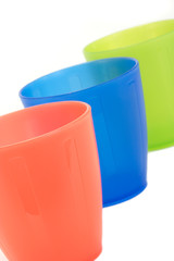 Three plastic cups, isolated on a white background.