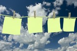 Four clean memo hanging on a cord. 3D image. poster