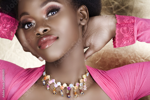beautiful African woman in pink summer top