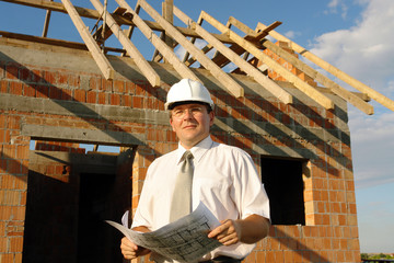 Building engineer holding building plans