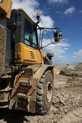 Vertical shot of a dumper truck in a quarry environment.