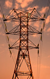 Power transmission pole against sunset skies poster