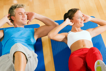 Couple doing Sit-ups