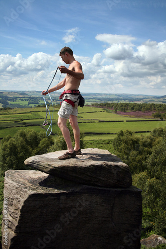 Gathering rope at the top of a climb