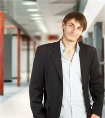 Young businessman walking in a corridor of a modern office