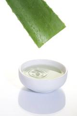 Aloe Vera sliced leaf with juice drop on white bowl