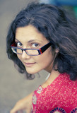 pretty brunet woman in glasses and red dress poster