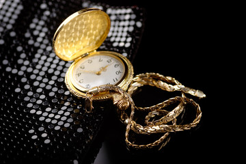 A golden chain and watch