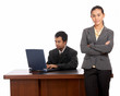 portrait of beautiful secretary standing infront of her boss