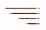 Four pencils different size on white background