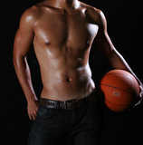 Asian hunky basketball player in blue jeans