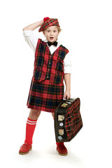 Surprised scotsman with suitcase on white background