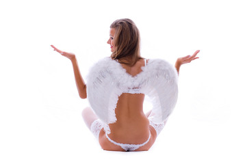 Sign balance. Young angel-girl sitting on clouds and