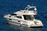 Small luxury Motor Yacht in the Mediterranean Sea poster