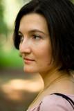 outdoor portrait of attractive brunet woman poster