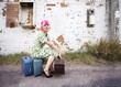 Woman with pink hair wearing polka dot dress in alley