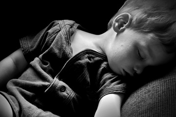 Sleeping boy portrait closeup in black and white