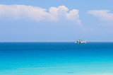Coast guard helicopter hovering above turquoise tropical ocean poster