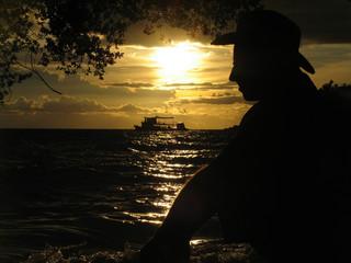 View at the beach with a man; Ko Thao Island, Thailand