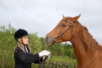 Girl -a jockey and horse