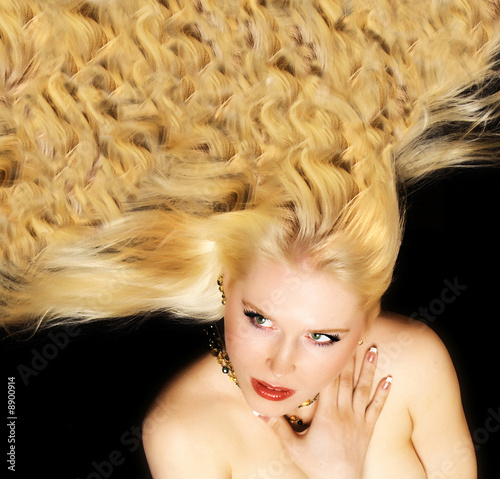 Beautiful lady with luxurious blond hair not isolated