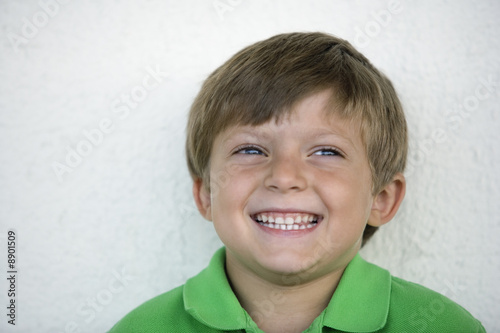 View of a cute boy smiling.