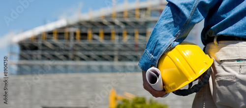 Fotobehang Industrial geb. A construction worker or foreman at a construction site