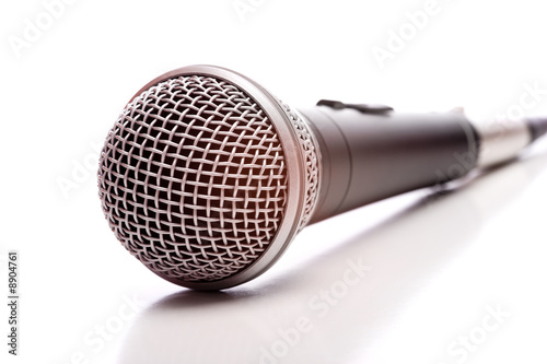 A microphone on a white background with copy space