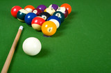 A set of billiards on a green felt table with copy space poster