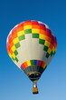A hot air balloon in front of a blue sky with copy space