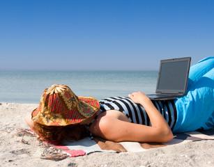 Girl with laptop computer sleep at sea coast