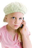 Young girl talking on the phone over white background