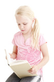 Young girl reading a book over white background