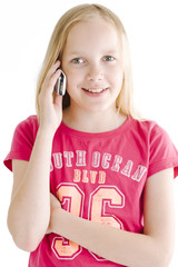 Young girl on the phone over white background