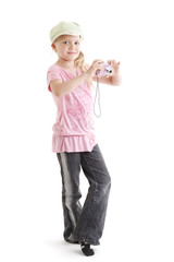 Young girl taking a photo with her digital camera