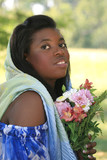 African-American young woman with flowers and head scarf poster