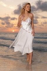 Woman on the beach during sunset