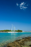 Sail boats docked in beautiful bay, Adriatic sea, Croatia poster