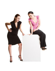 A shot of two businesswomen with a blank billboard