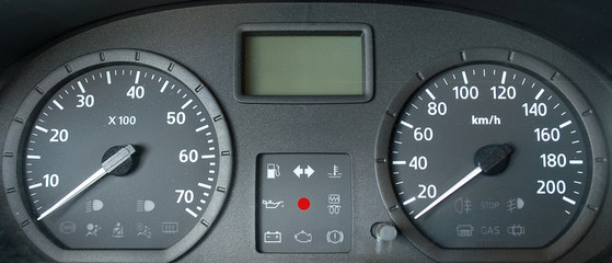 Grey dashboard of a new car. Front view.