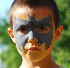 close-up of child painted in the face as a bat