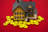 Smiley faces around a house, friendly mortgage company poster