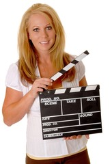 Young blond girl holding a cinema clapboard