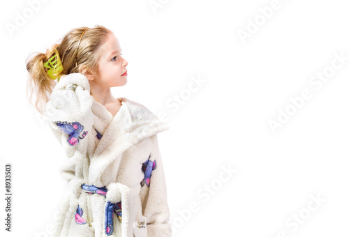 young girl with bathrobe on white background