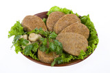 Ceramic plate with meat cutlets, mushrooms and greenery poster