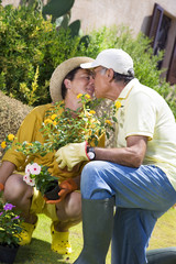 Portrait of senior Italian couple in garden